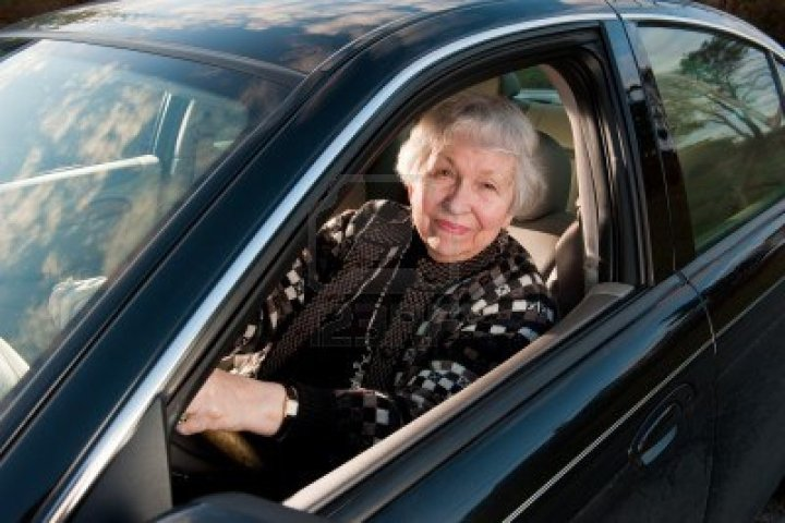 old woman in car